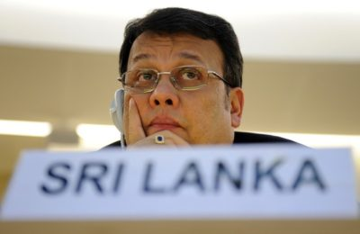 Sri Lanka's Cabinet Minister of Disaster Management and Human Rights Mahinda Samarasinghe looks on during the United Nations Human Rights Council special session on Sri Lanka on May 26, 2009 in Geneva. UN human rights chief Navi Pillay on Tuesday called for an international investigation into attacks on civilians during the final stages of the civil war in Sri Lanka.  AFP PHOTO / FABRICE COFFRINI (Photo credit should read FABRICE COFFRINI/AFP/Getty Images)