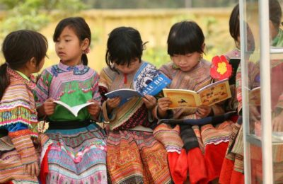 Girls from an indigenous community read outdoors at Ban Pho Primary School in Bac Han District in remote Lao Cai Province. The UNICEF-supported school provides education in a safe, child-friendly learning environment and includes classes taught in the childrens indigenous language.  In March 2009 in Viet Nam, UNICEF is supporting the Ministry of Education and Training (MOET) to provide bilingual education to ethnic minority children  in Vietnamese and their indigenous language  and to improve adolescent learning, especially among minority ethnic girls. The Norwegian Government and IKEA, the Swedish home-furnishings retailer, are major UNICEF funding partners. Norway has committed US $1.6 million, and IKEA has contributed more than US $1 million for these projects. Although 95 per cent of all eligible children attend primary school, an estimated 20 per cent of the children of the 11 million members of ethnic minorities do not have access to basic education. Additionally, drop-out rates among ethnic minorities are high due to the lack of trained bilingual teachers, limited bilingual texts and curricula and inadequate infrastructure. Adolescent girls are especially at risk because of poverty, cultural biases against gender equity in education and the lack of properly equipped child-friendly schools. UNICEF has worked with MOET since 2007 to research and implement educational models that support bilingual education for indigenous minorities, now benefiting some 5,000 students (including preschoolers) from the Hmong, Jrai and Khmer ethnic groups in the provinces of Lao Cai, Gia Lai and Tra Vinh. The programme to improve adolescent education, adding critical life skills, reaches an estimated 120,000 students and 3,000 out-of-school adolescents, in eight provinces. IKEA is UNICEFs largest corporate funding partner, supporting UNICEF education, child protection and health programmes for children in Asia, Africa and Europe.