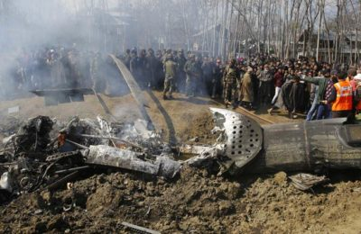 Locals gather as army soldiers stand near the wreckage of an aircraft after it crashed in Garend Kalan village of central Kashmir's Budgam district.Express Photo by Shuaib Masoodi 27/02/2019